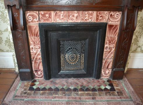 Beautiful tile set and fireplace front from 1890 Victorian house