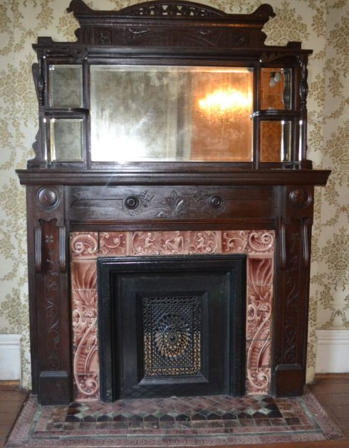 Carved, solid wood mantel from 1890 Victorian House