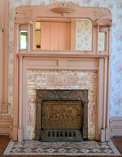 Solid wood, mirrored mantel with side columns