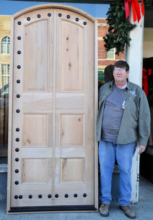 Roger Long stands next to one of the many doors that he has custom built for Southern Accents customers.