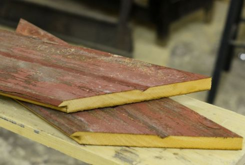 Tongue and groove boards were cut and the edges mitered for use in framing our chalk board.