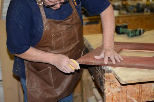 Roger lightly sanded the trim at each corner, giving the frame a nice polished look.