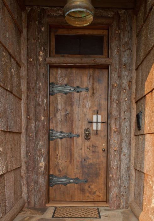 This magnificent door was custom built by Southern Accents from a slab of salvaged wood for customer Ann Pollard.