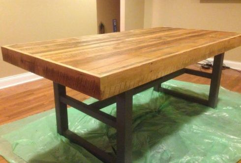 Ryan built this table top for a customer who wanted to combine the beauty of aged, salvaged wood with a more modern industrial base that he already owned.