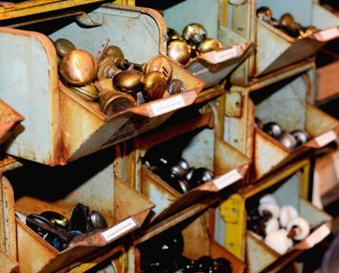 Southern Accents has one of the largest collections of salvaged hardware in the Southeast. These bins are filled with salvaged brass, glass, and porcelain knobs.