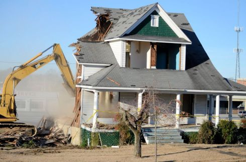 Once all salvage operations to the interior of the house were complete, the final demolition work began. A cloud of dust rises from the rubble as the machines begin to slowly tear down the walls.