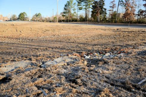 This now empty lot was the final resting place for the Hays house. All that remains are tire tracks and a few scattered pieces of rubble.