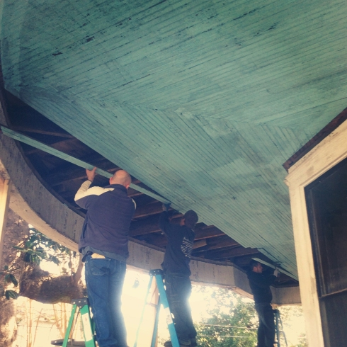 The Southern Accents team salvaging this beautiful blue porch ceiling from an 1890's house in Greenville, Alabama.