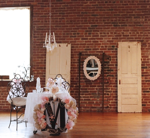 The white doors added an element of light against the dark brick walls.