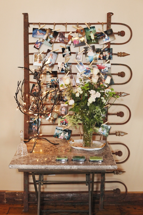 Twine was strung to this antique wrought iron gate and used to display childhood photos of the bride and groom.