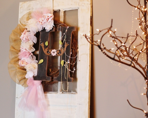 The entrance of the venue set the tone for this vintage themed wedding with the use of salvaged doors, ironwork, and hand crafted wreaths.