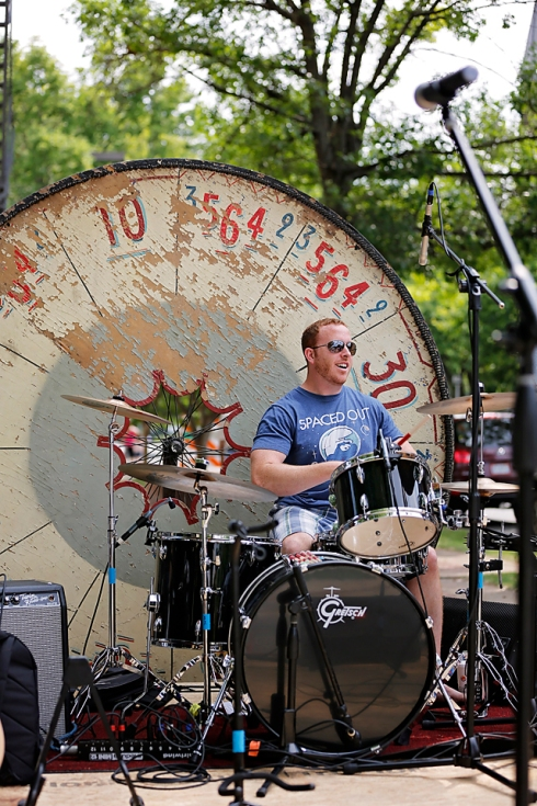 "Our antique carnival wheel created a very cool backdrop for the drummers! This piece was added to our stage ""by request."""