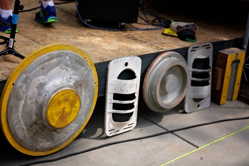 We used salvaged industrial molds and gas heater masks to create interest along the stage side.