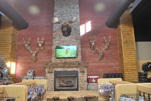Salvaged red barn wood from Southern Accents was used to cover this wall at Grabow Outdoors in Fultondale, Alabama.