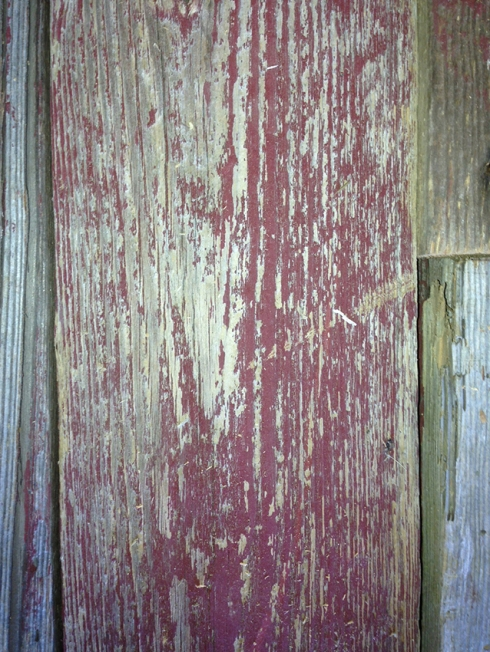 This salvaged red barn wood currently sits in our Wood Warehouse.