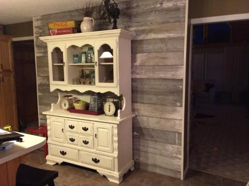 The Smith's finished barn wood kitchen wall looks fabulous!