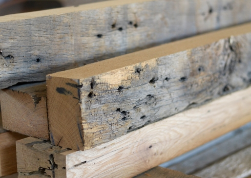 This beautiful piece of furniture started out as a pile of salvaged oak beams