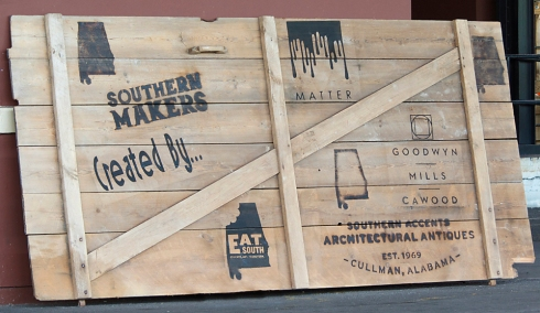 The logo of each Southern Makers 2014 curator was stenciled onto this large barn door and displayed at the event.