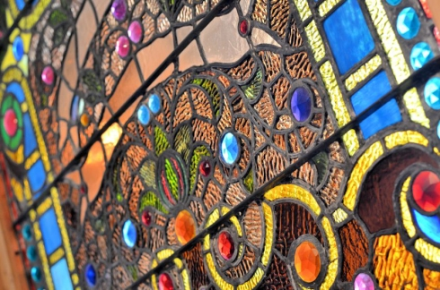 This jeweled, stained glass window is the most gorgeous piece that we have ever had pass through our showroom.