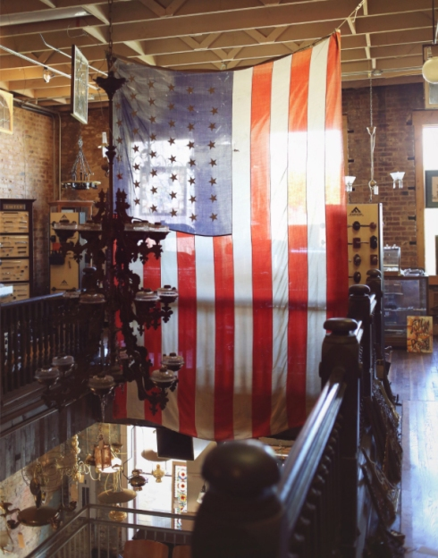 This 3-tier iron chandelier, hung over the staircase in front of our huge American flag, has been one of the most photographed pieces in our showroom!