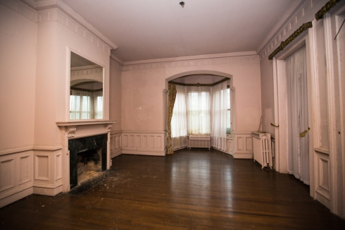 One of two keeping rooms located at the front of the house