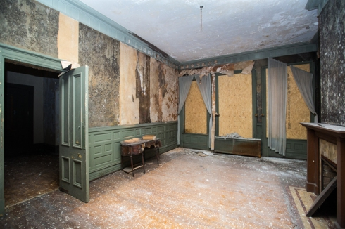 Formal dining room. The dark spots on the wallpaper is mold