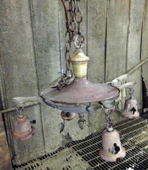 The fixture has been stripped of the old paint and cleaned. It will be rewired and fully restored.