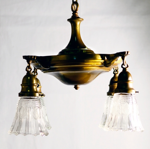 This pan light fixture has been cleaned, rewired, equipped with replacement glass shades and is ready for a new home!