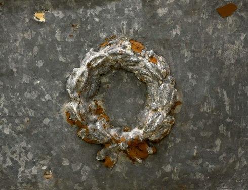 Salvaged decorative tin piece from Philadelphia