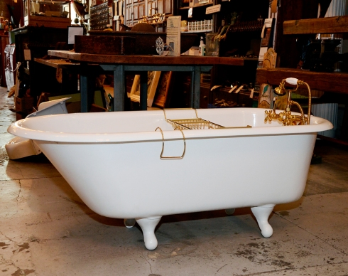 This salvaged, cast iron, claw foot tub has been totally refinished, fitted with new feet and is ready for it's new home!