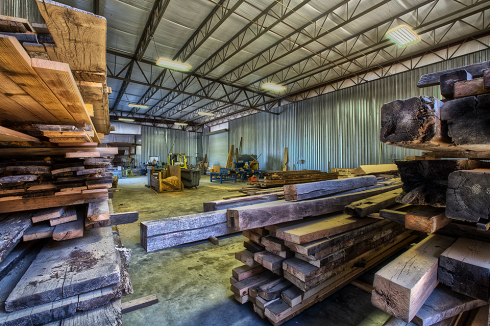 Our new facility houses much of our salvaged circular sawn and handhewn timbers. The timbers are available in a natural or oiled finish. They can be left in the rough or sanded. We can also mill them to any desired length for use as rustic mantels.