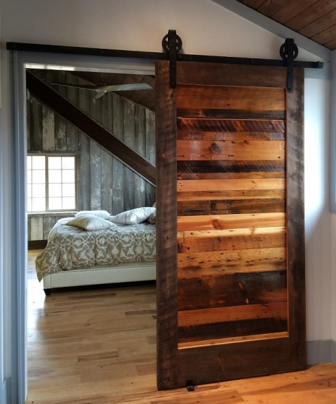 This gorgeous sliding door was custom built in our wood shop using reclaimed wood.