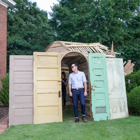 The tunnel exited into the back yard where salvaged doors were used to help further create a visual screen.