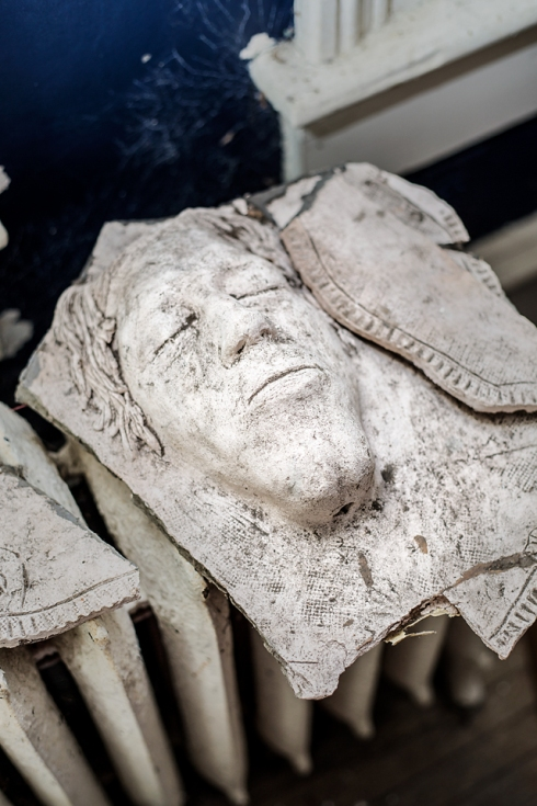 This mask, believed to be a death mask, was found in one of the bedrooms.